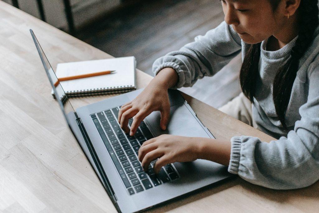 girl doing study on laptop
