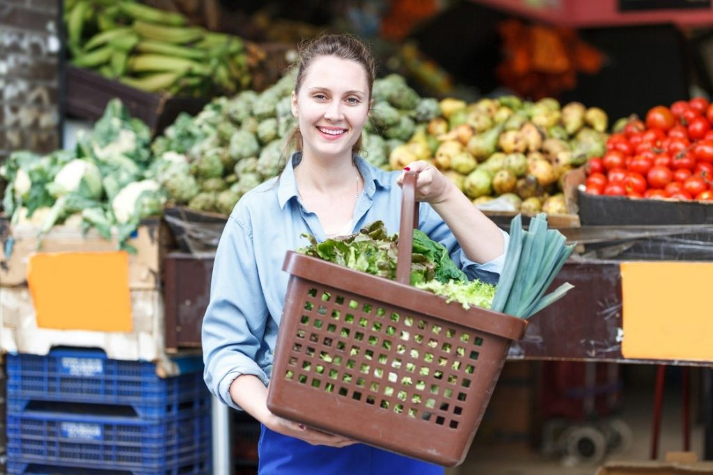 woman carrying vegetables in basket